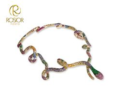 19,2k gold Serpent necklace. Diamonds, Sapphires, Emeralds and Rubis.