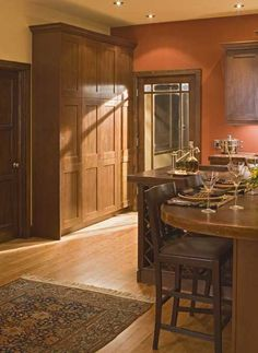 Prairie Style Kitchen With Rust Colored Walls