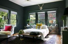 Windows, light bedding, dark paint.