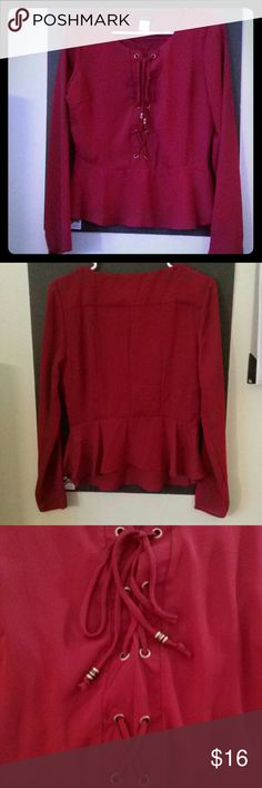 Beautiful red blouse. The material is sheet and light weight. This vows can be worn dressed up with some heels or casually with some jeans. It's brand new never been worn you'll have fun with it! VENUS Tops Blouses