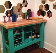 Ikea Hack: Groland Kitchen Island, Hutton Wine rack. I think I would go with white, but I love the idea.