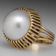 This lovely retro vintage mabe pearl cocktail ring features a wire bezel mounting and openwork details. The ring is crafted of solid gold with a high carat gold wash and is in good condition showing some areas of wear to the wash. 14k Gold Jewelry, Pearl Jewelry, Fine Jewelry, Jewelry Making, Vintage Rings, Vintage Jewelry, Pearl Ring, Cocktail Rings, Ring Designs
