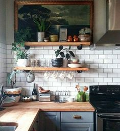 Pale blue kitchen units with white subway tiles
