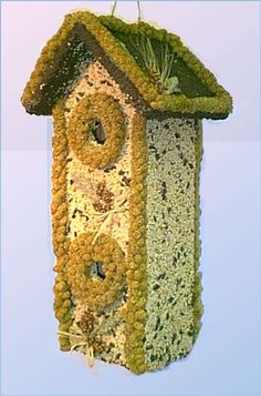 Two-Story Edible Birdhouse, your basic bird seed covered edible birdhouse with a bit of flair decorating the roof.