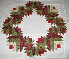 Wreath of christmas fabrics (red/green).  Log Cabin variation