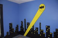Batman Bedroom.  Mother's blog with great ideas on how to paint a batman cityscape backdrop. [http://creativeeyedias.blogspot.co.uk/]