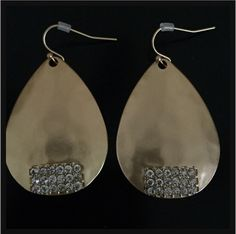 Teardrop crystals in hammered gold or silver. Stunning earrings.