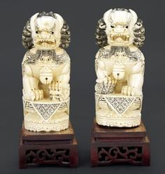A Pair of Chinese Carved Ivory Foo Lions. : Lot 1703170