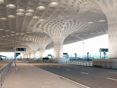 The airports arrivals and departures area offers passengers shelter from rain, particularly during India's monsoon season. Though Formglas made the FRP molds for the exterior panels, a Chinese company fabricated the GFRC panels. Two 400-millimeter-diameter roof drains run down each exterior and interior column behind the panels.