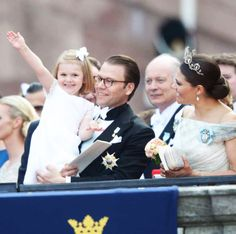 hrhroyalty: Wedding of Prince Carl Philip of Sweden and Sofia Hellqvist, June 13, 2015-Princess Estelle waves to the crown in the arms of her father Prince Daniel as mother Crown Princess Victoria looks on