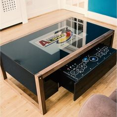 Arcane Arcade Table: Price: Combining elegant design and clever construction with unadulterated, retro excellence, sitting down… Arcade Retro, Pi Arcade, Arcade Stick, Arcade Games, Coffee Table Arcade Machine, Arcade Table, Arcade Console, Coffee Tables For Sale, Coffee Table Books