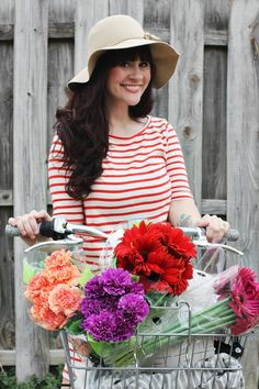 striped shirt, hat, flowers, bicycle, red, white
