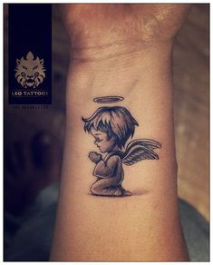 Black and grey small baby angel tattoo tattoo melek dövme, d Small Angel Tattoo, Angel Tattoo For Women, Baby Angel Tattoo, Wrist Tattoos For Women, Tattoos For Guys, Guardian Angel Tattoo, Boy Tattoos, Family Tattoos, Couple Tattoos
