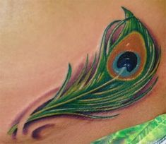 Small Peacock Feather Tattoo