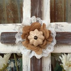 Shabby Chic cross, Reclaimed wood, has a rustic white and chalky brown patina accented  with a cream porcelain knob, burlap rose & lace. 1st layer painted in rustic white and crème patina. 2nd layer is painted in a  chalky brown patina.