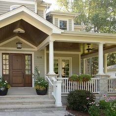 natural wood door (have one) white post, white rails with stone pillars/columns? wider steps?