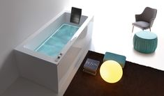 Modern Bathtub With Led Lighting - Dream of Treesse -  To combine ambient light and water, does not seem a good idea as it creates partnerships with electric shock immediately.