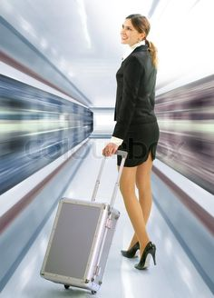 1668261-business-traveler-with-luggage-and-speed-train-on-station.jpg (575×800)