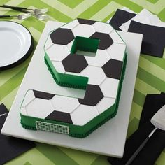 Celebrate your team's big win with this Go for the Goal Soccer Cake. Made using the Countless Celebrations Cake pan Set, you can create a cake in any number (or letter) shape you'd like. Soccer Cupcakes, Soccer Ball Cake, Football Birthday Cake, 9th Birthday Cake, Soccer Birthday Parties, Soccer Party, Football Cakes For Boys, Soccer Theme, Create A Cake