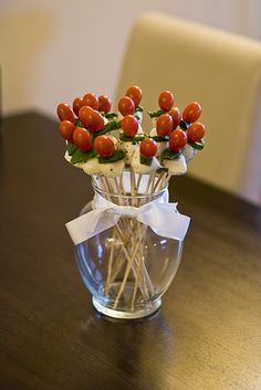Caprese Bouquet A different take on traditional Italian caprese salad. We used sweet grape tomatoes, basil leaves and mozzarella balls marinated in olive oil, salt, pepper and Italian seasonings. Stick a skewer through all the ingredients and arrange in a flower vase. How cute is that? It was so easy too! Perfect appetizer for a cocktail party or if you have guests over.