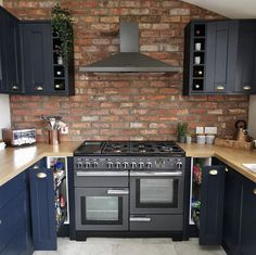 Brick Chimney Breast, Multi Storey Building, Shaker Style Kitchens, L Shaped Kitchen, Brick Tiles, Leather Dining Chairs, Exposed Brick, Kitchen Styling, Victorian Homes