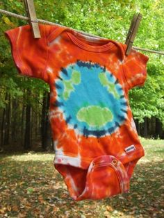 "Tie Dye Onesie featuring Earth with a bright orange background.  If you like this one, search for her ""earth in space"" one."
