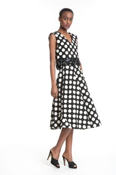 Beaded Crop & Side Zip Skirt - This black and white polka dotted top paired with matching polka dotted skirt makes for a fun vintage appearance!