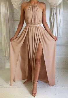 Try on this slit halter dress for a tad revealing, yet completely stunning look.