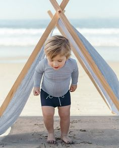 Sandy toes + salty hair + sweet stripes and stylish shorties = the perfect beach day with your little one. Shop http://www.minnowswim.com/ for this look & more! x