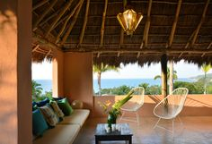Casita Luna is a very romantic vacation retreat for a couple or a couple with a child in Sayulita, Mexico. It feels like a tree house high above the ocean with Mexican colors and crafts combined with a modern design that gives it a fresh and breezy feel.