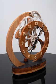 Woodworking Plans Wooden Gear Clock Plans from Hawaii by Clayton Boyer Wooden Gear Clock, Wooden Gears, Wooden Clock Plans, Woodworking Furniture, Woodworking Projects, Woodworking Quotes, Woodworking Garage, Intarsia Woodworking, Woodworking Supplies