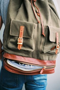 Great example of waxed canvas outside pockets. The leather closing straps work really well.