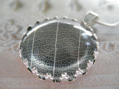 White Skeleton Leaf Pendant Beneath Glass by giftforallseasons