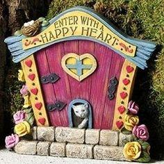Happy Heart Fairy Door. www.teeliesfairygarden.com . . . Beautify your romantic fairy garden with this happy door that features a cute cat peeking out. #fairydoor