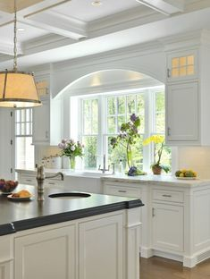 kitchens - Robert Abbey Chase Pendant coffered ceiling white kitchen cabinets marble countertops farmhouse sink white kitchen island ebony stained beveled butcher block countertop small round sink in kitchen island Robert Abbey Chase Pendant