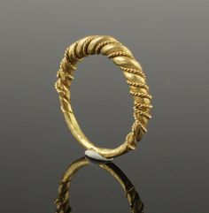 VIKING TWISTED GOLD RING - CIRCA 10TH CENTURY AD