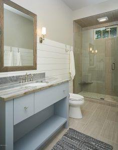 Bathroom Shiplap Wainscoting. Bathroom features wall shiplap wainscoting and neutral floor and shower tiles. #Bathroom #Shiplap #Wainscoting #Bathroomwainscoting #bathroomshiplap #bathroomwall