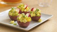 Turn potato salad into a potluck appetizer by serving it in small red potato shells.