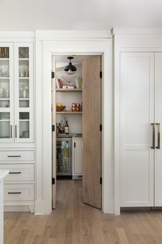 Pantry Kitchen pantry The pantry features custom vertical cabinetry and a White Oak door Pantry Kitchen pantry #Pantry #Kitchenpantry #whiteoak