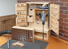 Rotary Tool Cabinet Woodsmith Plans might be good for a sewing cabinet threa Rotary Tool Cabi Dremel Projects, Carpentry Projects, Wood Projects, Dremel Ideas, Woodworking Workshop, Woodworking Crafts, Woodworking Projects, Teds Woodworking, Woodworking Basics