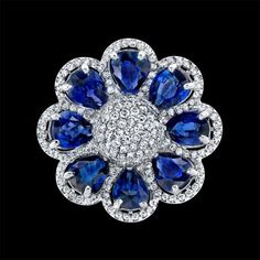 Pear Shape Blue Sapphires Flower Ring set in pave 18K White Gold Norman Silverman Diamonds