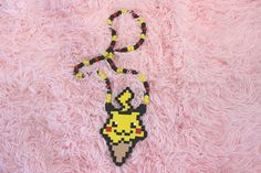 Hey, I found this really awesome Etsy listing at https://www.etsy.com/listing/540263658/pikachu-ice-cream-kandi-necklace
