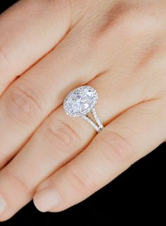 Petite diamond halo and split band, with an oval diamond. A gorgeous engagement ring by Ascot Diamonds #ascotdiamonds