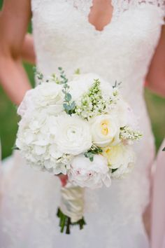 Creamy White Bouquet |  On SMP:  http://www.StyleMePretty.com/2014/02/24/sioux-falls-south-dakota-wedding-at-steever-house-bed-breakfast/Jeff Sampson Photography