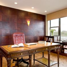 """""""The wall behind the desk is covered is 13"""" x 13"""" embossed leather tiles."""