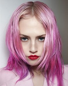 Pink hair. Red lips. We love Charlotte Free's colorful look.