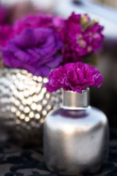 Having a grey wedding? Use silver to make your centerpieces more exciting! #graywedding #weddingdecor