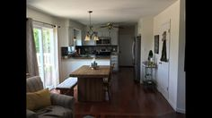This was our kitchen before the remodel. We wanted to use the entire space for an island and remove the peninsula. White Kitchen Island, This Is Us, Space, Table, Furniture, Home Decor, Floor Space, Decoration Home, Room Decor