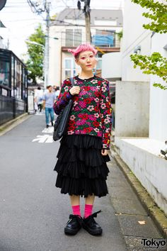Accessory designer Shiho Tabei on the street in Harajuku wearing a floral top by Comme Des Garcons with a Sunao Kuwahara ruffle skirt, Tokyo bopper ribbon laced platforms, and earrings of her own design.
