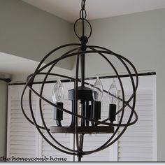 DIY your own Restoration Hardware inspired orb chandelier with this tutorial. Restoration Hardware Store, Orb Chandelier, Chandeliers, Chandelier Makeover, Rustic Chandelier, Diy Luminaire, Diy Light Fixtures, Up House, Rustic Contemporary